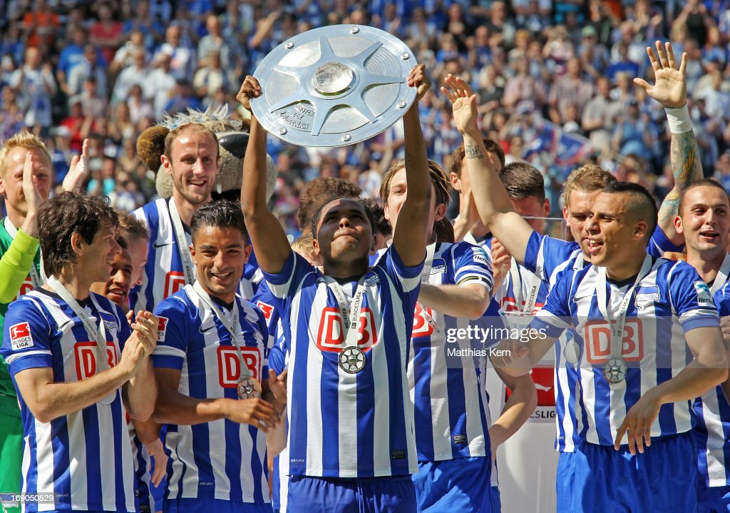 Ronny (C) of Berlin and his team mates pose with the cup after winning the championship after the Second Bundesliga match between Hertha BSC Berlin and FC Energie Cottbus at Olympic stadium on May 19, 2013 in Berlin, Germany.
