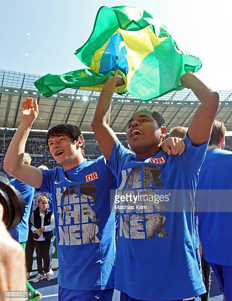 Ronny of Berlin and team mate Nico Schulz celebrate winning the championship after the Second Bundesliga match between Hertha BSC Berlin and FC...