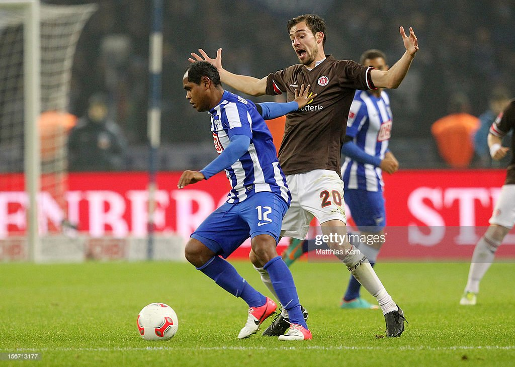 Ronny (L) of Berlin battles for the ball with Sebastian Schachten (R) of St. Pauli during the Second Bundesliga match between Hertha BSC Berlin and FC St. Pauli at Olympic stadium on November 19, 2012 in Berlin, Germany.