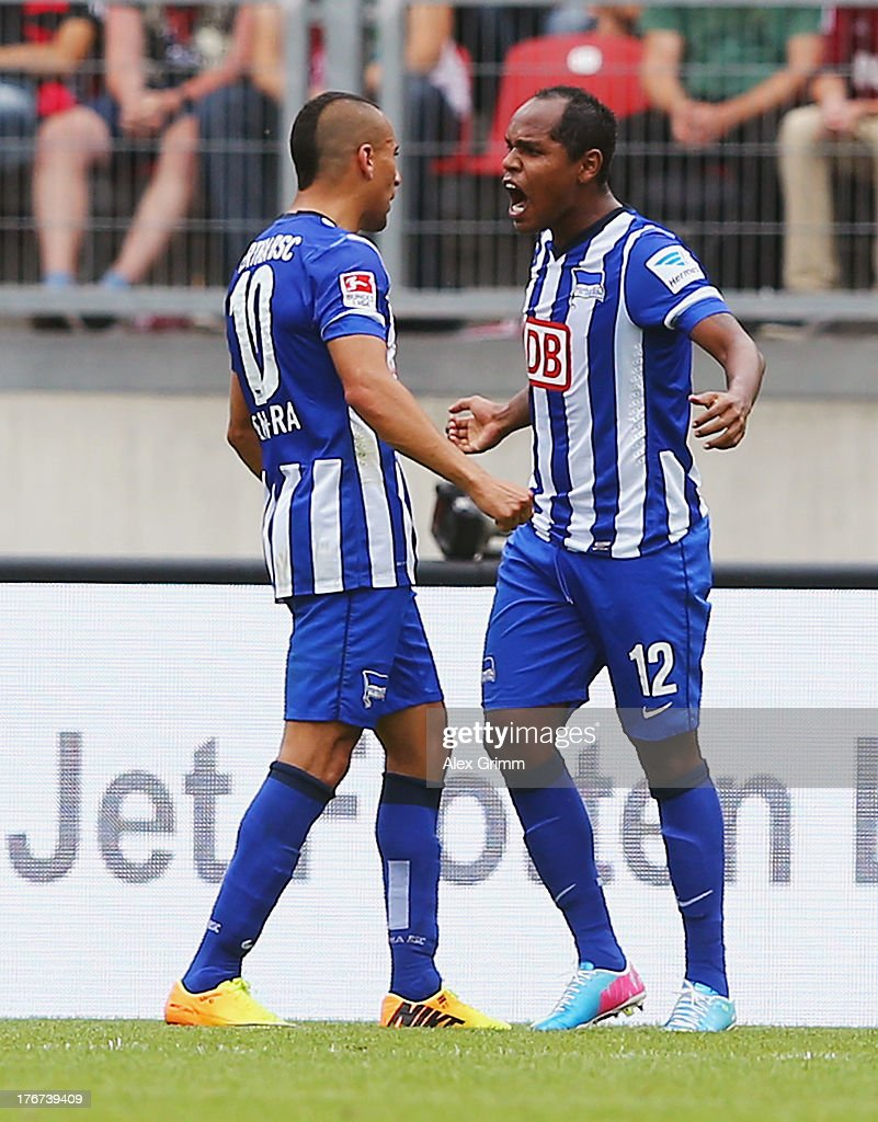 Ronny (R) of Berlin celebrates his team's second goal with team mate Aenis Ben-Hatira during the Bundesliga match between 1. FC Nuernberg and Hertha BSC Berlin at Grundig Stadium on August 18, 2013 in Nuremberg, Germany.