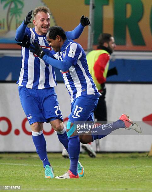 Ronny of Berlin jubilates with team mate Marvin Knoll after scoring the third goal during the Second Bundesliga match between FC Energie Cottbus and...