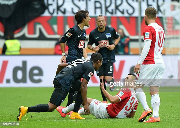 Ronny of Hertha BSC and Nikola Djurdjic of FC Augsburg clash during the game between FC Augsburg and Hertha BSC on September 28 2014 in Augsburg...