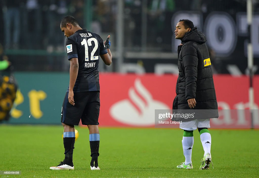 Ronny of Hertha BSC and Raffael of Borussia Moenchengladbach chat after the match between Borussia Moenchengladbach and Hertha BSC on December 6, 2014 in Berlin, Germany.