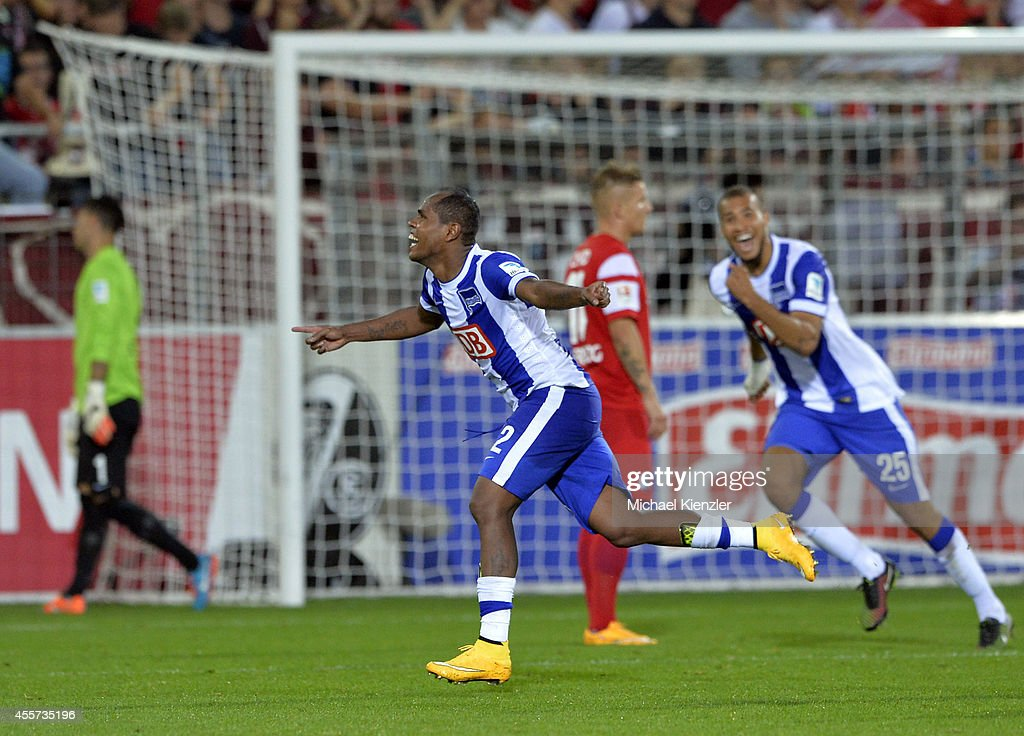 Ronny (L) of Hertha BSC celebrates his second goal with John Antony Brooks (R) during the Bundesliga match between SC Freiburg and Hertha BSC at Mage Solar Stadium on September 19, 2014 in Freiburg, Germany.