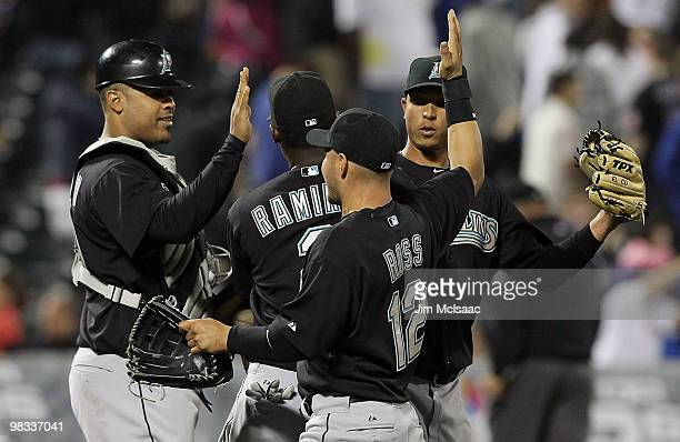 Ronny Paulino Hanley Ramirez Cody Ross and Leo Nunez of the Florida Marlins celebrate after defeating the New York Mets on April 8 2010 at Citi Field...