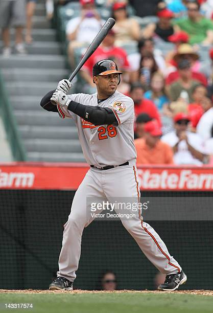 Ronny Paulino of the Baltimore Orioles bats during the MLB game against the Los Angeles Angels of Anaheim at Angel Stadium of Anaheim on April 22...