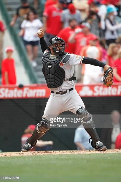 Ronny Paulino of the Baltimore Orioles throws down to second during the game against the Los Angeles Angels of Anaheim on April 22 2012 at Angel...