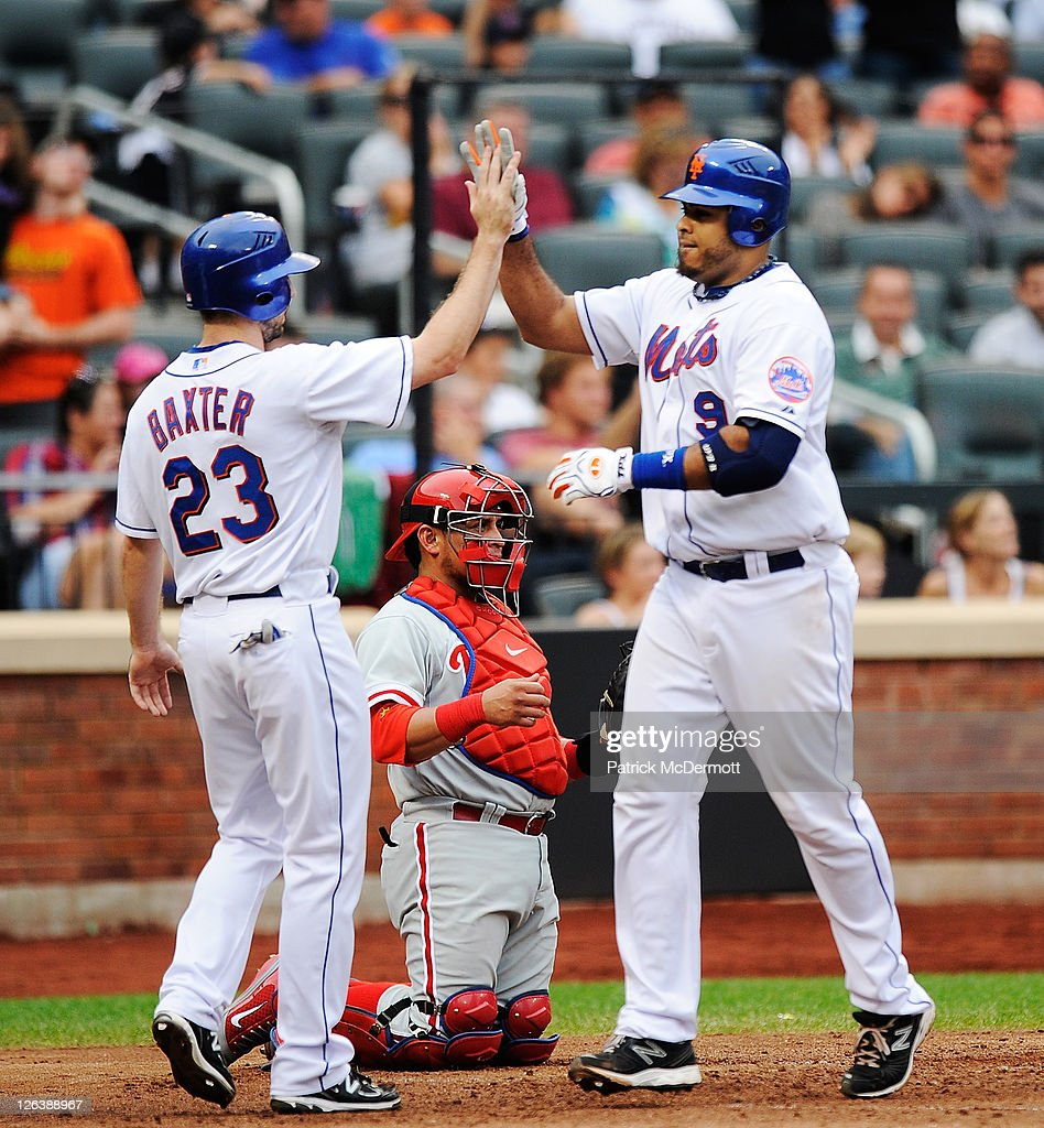 Ronny Paulino #9 of the New York Mets celebrates his two run homerun with Mike Baxter #23 after scoring in the seventh inning against the Philadelphia Phillies at Citi Field on September 25, 2011 in the Flushing neighborhood of the Queens borough of New York City.