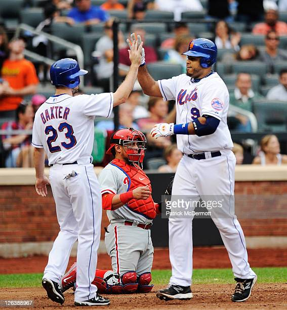 Ronny Paulino of the New York Mets celebrates his two run homerun with Mike Baxter after scoring in the seventh inning against the Philadelphia...
