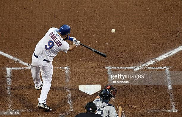 Ronny Paulino of the New York Mets connects on a second inning base hit against the New York Yankees at Citi Field on July 1 2011 in the Flushing...