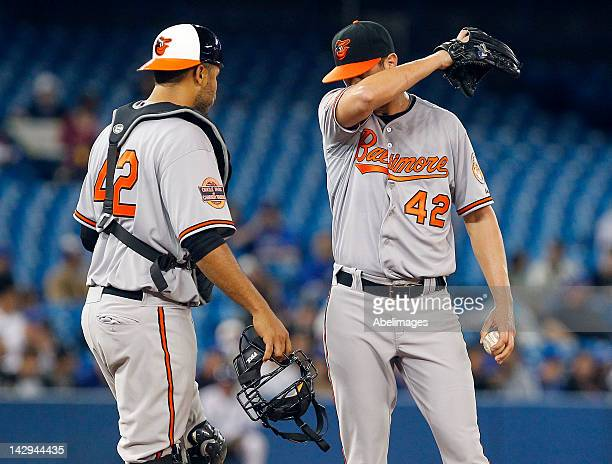 Ronny Paulino talks to Omar Vizquel of the Baltimore Orioles during MLB action against the Toronto Blue Jays at the Rogers Centre April 15 2012 in...