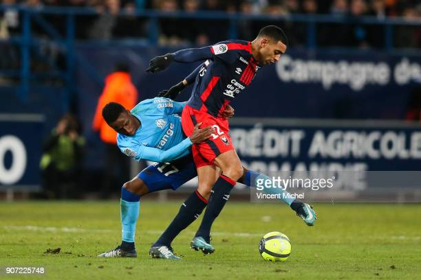 Ronny Rodelin of Caen and Bouna Sarr of Marseille during the Ligue 1 match between Caen and Olympique de Marseille at Stade Michel D'Ornano on...