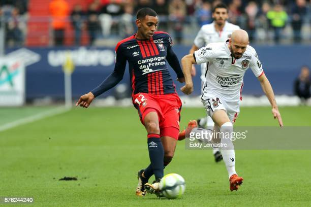 Ronny Rodelin of Caen and Christophe Jallet of Nice during the Ligue 1 match between SM Caen and OGC Nice at Stade Michel D'Ornano on November 19...