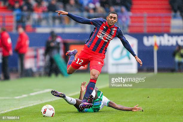 Ronny Rodelin of Caen and Henri Saivet of SaintEtienne during the Ligue 1 match between SM Caen and AS SaintEtienne at Stade Michel D'Ornano on...