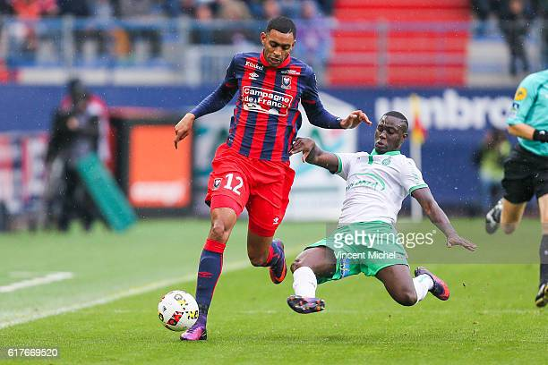 Ronny Rodelin of Caen and Henri Saivet of Saint-Etienne during the Ligue 1 match between SM Caen and AS Saint-Etienne at Stade Michel D'Ornano on...