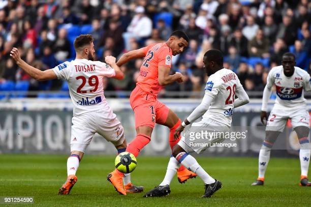 Ronny Rodelin of Caen Lucas Tousart and Tanguy Ndombele Alvaro of Lyon during the Ligue 1 match between Olympique Lyonnais and SM Caen at Parc...