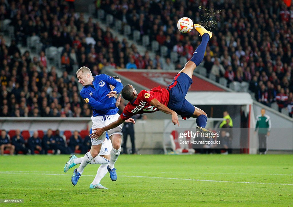Ronny Rodelin of Lille is challenged by Tony Hibbert of Everton as he attempts a spectacular shot on goal during the UEFA Europa League Group H match between LOSC Lille and Everton at Grand Stade Lille Metropole on October 23, 2014 in Lille, France.