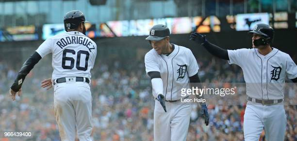 Ronny Rodriguez celebrates after scoring on the John Hicks single to centerfield with teammates Victor Reyes and JaCoby Jones of the Detroit Tigers...