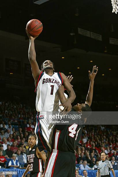 Ronny Turiaf of the Gonzaga University Bulldogs shoots over Darryl Dora of the Texas Tech University Red Raiders during the second round of the NCAA...