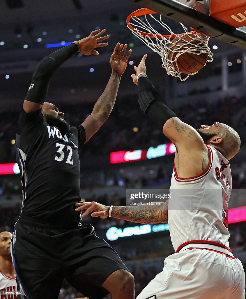 Ronny Turiaf #32 of the Minnesota Timberwolves dunks over Carlos Boozer #5 of the Chicago Bulls at the United Center on January 27, 2014 in Chicago, Illinois.