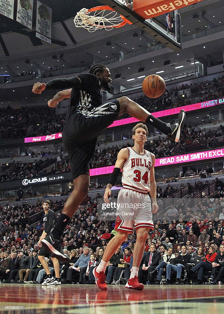 Ronny Turiaf #32 of the Minnesota Timberwolves dunks over Mike Dunleavy #34 of the Chicago Bulls at the United Center on January 27, 2014 in Chicago, Illinois.