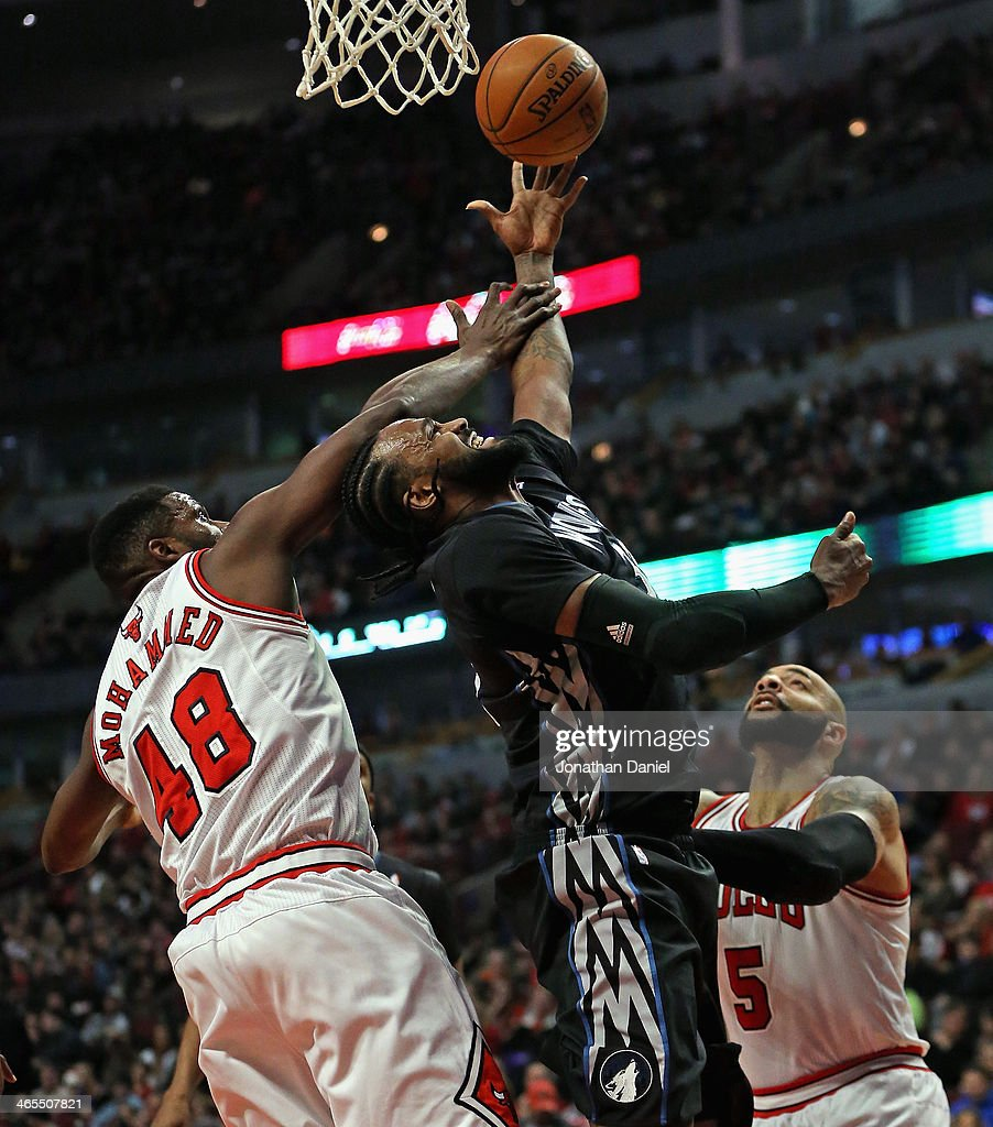 Ronny Turiaf #32 of the Minnesota Timberwolves is fouled by Nazr Mohammed #48 of the Chicago Bulls as he tries to shoot over Carlos Boozer #5 at the United Center on January 27, 2014 in Chicago, Illinois.