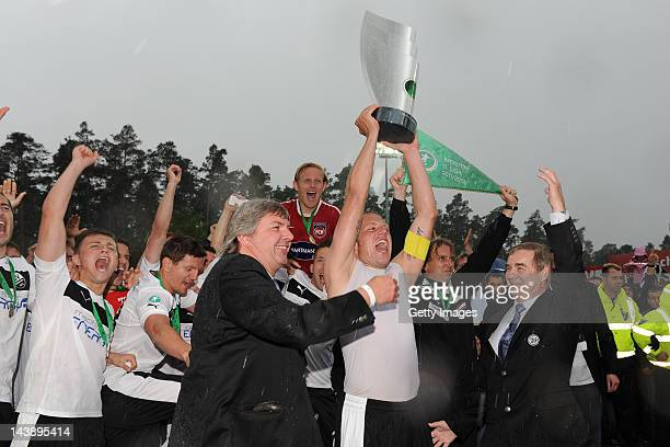 Ronny Zimmerman presents the bowl to Frank Loening of SV Sandhausen who won the third league after the Third League match between SV Sandhausen and 1...