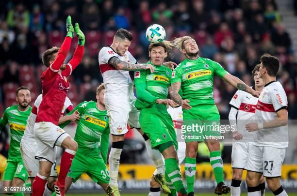 RonRobert Zieler Daniel Ginczek of VfB Stuttgart Jannik Vestergaard and Raul Bobadilla of Borussia Moenchengladbach battle for the ball during the...