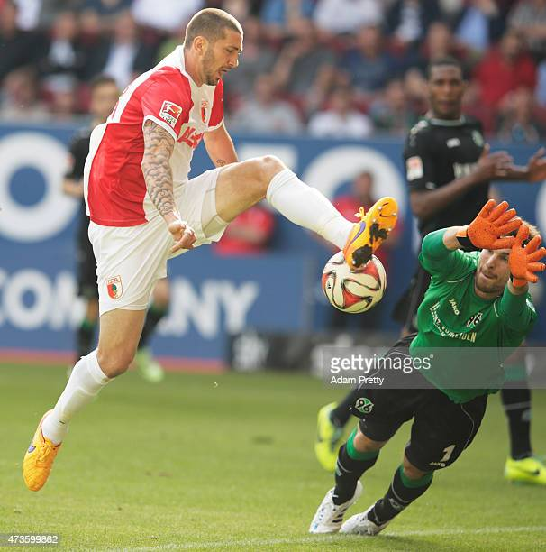 RonRobert Zieler of Hannover 96 saves a goal attempt from Sascha Moelders of FC Augsburg during the Bundesliga match between FC Augsburg and Hannover...