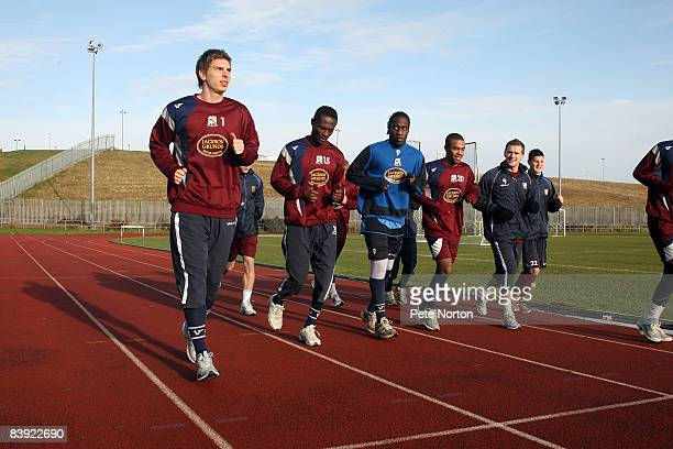 RonRobert Zieler of Northampton Town runs with his teammates during a training session at the Sixfields Stadium on December 4 2008 in Northampton...