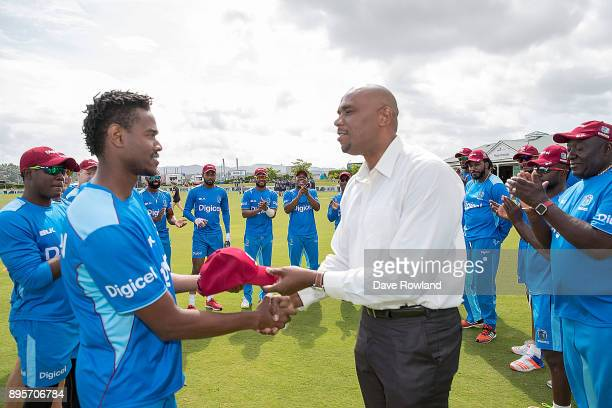 Ronsford Beaton of West Indies is presented with his cap by Ian Bishop before the first match in the One Day International series between New Zealand...