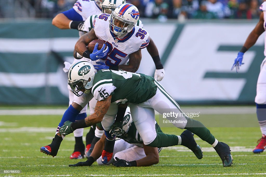 Rontez Miles #45 of the New York Jets tackles Mike Gillislee #35 of the Buffalo Bills during the second half at MetLife Stadium on January 1, 2017 in East Rutherford, New Jersey.