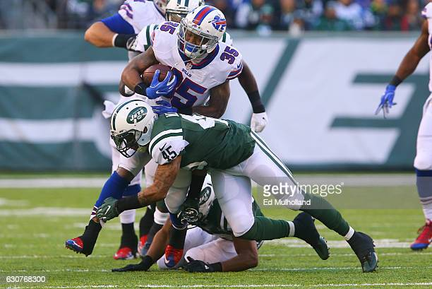Rontez Miles of the New York Jets tackles Mike Gillislee of the Buffalo Bills during the second half at MetLife Stadium on January 1, 2017 in East...
