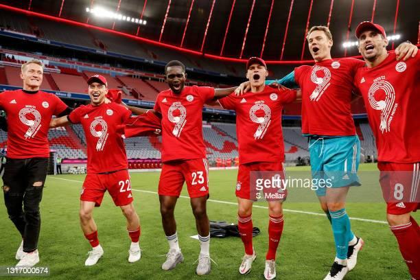 Ron-Thorben Hoffmann, Marc Roca, Tanguy Nianzou, Joshua Kimmich, Manuel Neuer and Javi Martinez of Bayern Muenchen celebrate winning the league title...