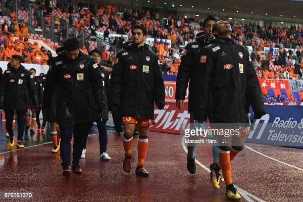 Rony and Albirex Niigata players show dejection after their relegation despite their 10 victory in the JLeague J1 match between Albirex Niigata and...