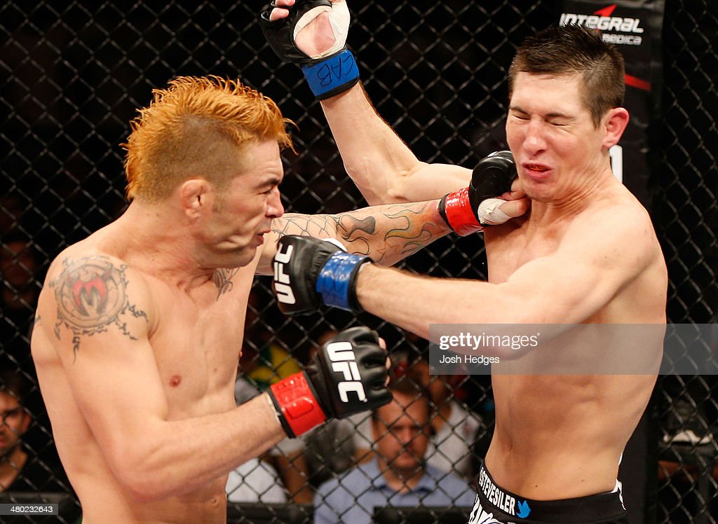 Rony 'Jason' Mariano-Bazzera and Steven Siler trade punches in their featherweight bout during the UFC Fight Night event at Ginasio Nelio Dias on March 23, 2014 in Natal, Brazil.