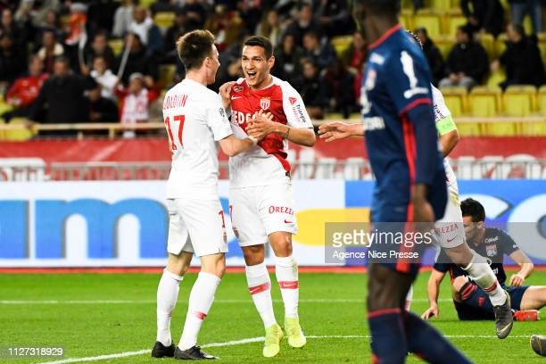 Rony Lopes of Monaco celebrates his goal with Aleksandr Golovin during the Ligue 1 match between Monaco and Lyon at Stade Louis II on February 24...