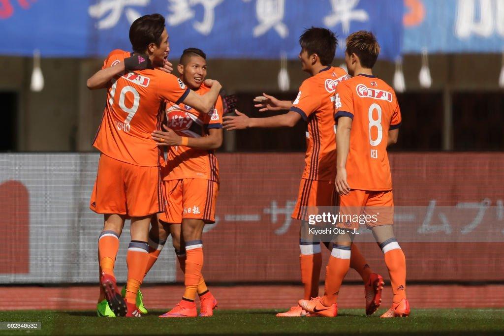 Rony (2nd L) of Albirex Niigata celebrates scoring his side's second goal with his team mates during the J.League J1 match between Albirex Niigata and Gamba Osaka at Denka Big Swan Stadium on April 1, 2017 in Niigata, Japan.
