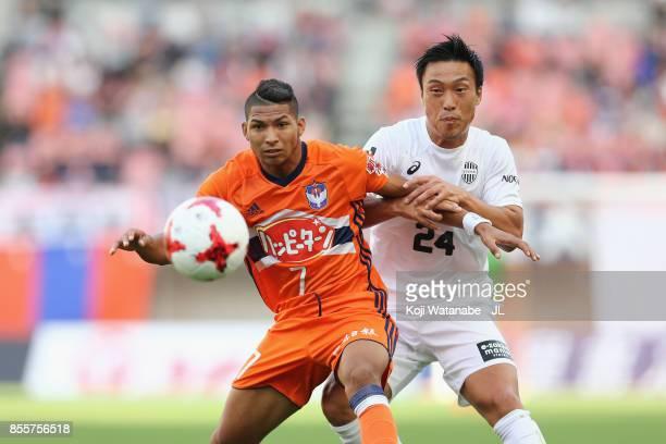 Rony of Albirex Niigata controls the ball under pressure of Masatoshi Mihara of Vissel Kobe during the JLeague J1 match between Albirex Niigata and...