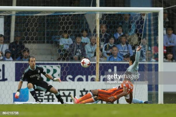 Rony of Albirex Niigata scores the opening goal during the JLeague J1 match between Jubilo Iwata and Albirex Niigata at Yamaha Stadium on October 21...