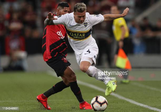 Rony of Athletico PR struggles for the ball with Julio Buffarini of Boca Juniors during a match between Athletico PR and Boca Juniors as part of Copa...