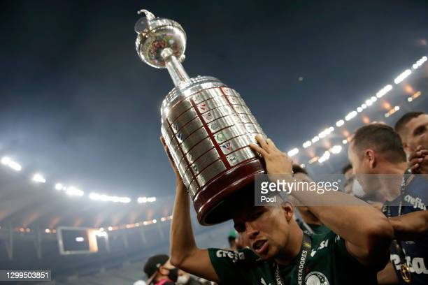 Rony of Palmeiras carries the Copa CONMEBOL Libertadores trophy after the final of Copa CONMEBOL Libertadores 2020 between Palmeiras and Santos at...
