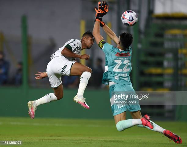 Rony of Palmeiras kicks the ball against Ezequiel Unsain of Defensa y Justicia to score the the first goal of his team during match between Defensa y...