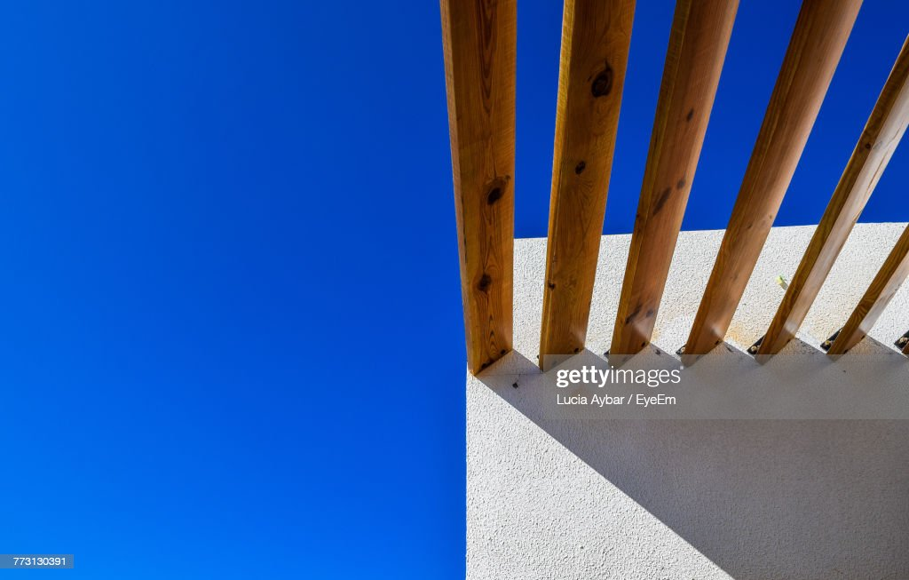 Roof Beams On Wall Against Clear Blue Sky : Photo