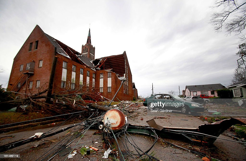Roof debris from Westminster Presbyterian Church and power lines sit in the street after a tornado tornado touched down yesterday evening February 11, 2013 in Hattiesburg, Mississippi. Hundreds of homes were destroyed and over sixty people injured when the tornado ripped through the town.