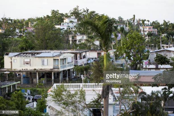 A roof destroyed from Hurricane Maria is seen at a home in Rio Grande Puerto Rico on Sunday Jan 21 2018 Before Hurricane Maria struck four months ago...