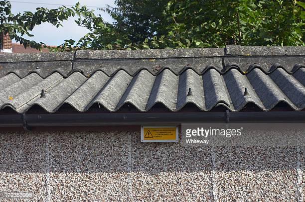 Asbestos roof and warning sign