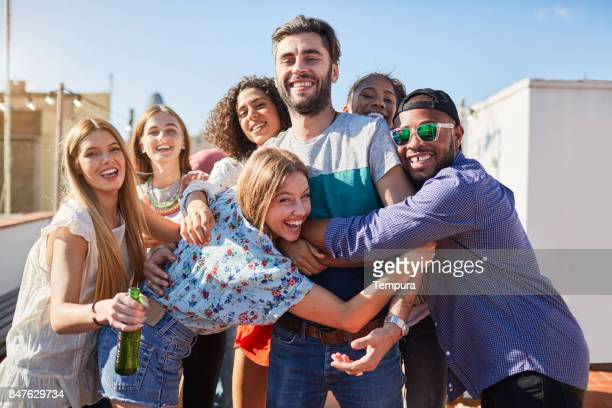 Roof garden party in Barcelona, young people celebrating.
