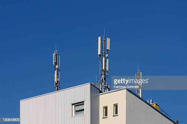 Roof of a residential building with mobile phone masts