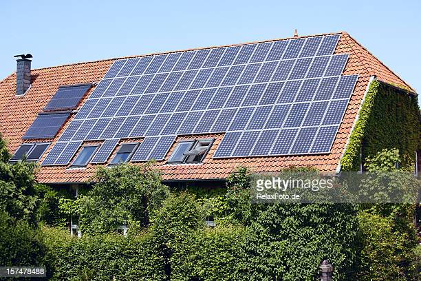 roof of farmhouse with solar panels (xxxl) - solar energy dish stock pictures, royalty-free photos & images